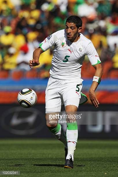 Rafik Halliche of Algeria runs with the ball during the 2010 FIFA World Cup South Africa Group C match between Algeria and Slovenia at the Peter...