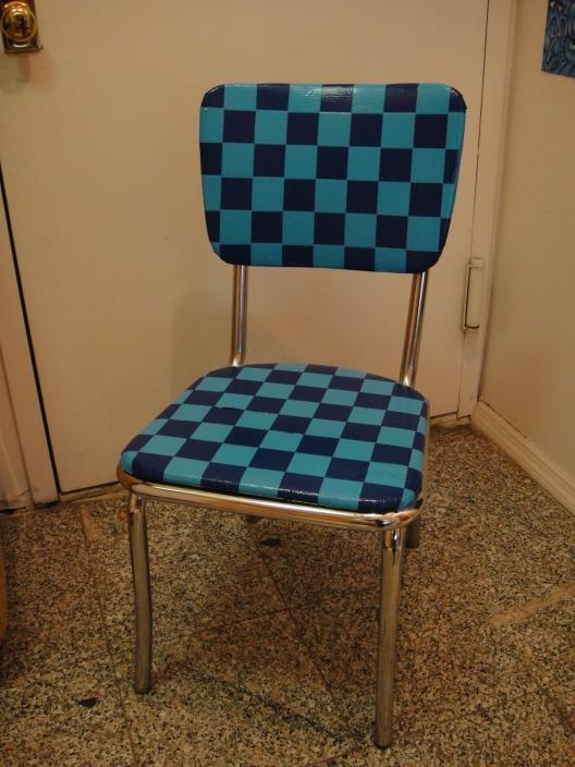 OH YES.  That is duct tape on a chair. I  could design an Alice in Wonderland themed chair.