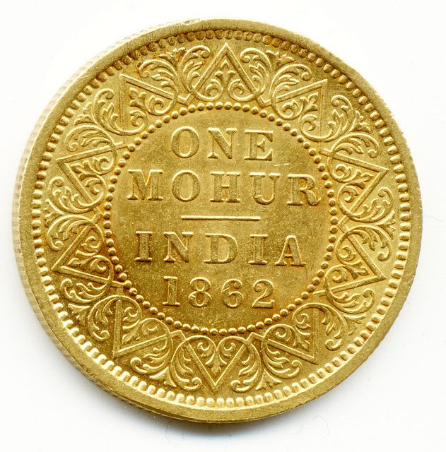I like keeping a shipping container full of these; just for a rainy day, or a sunny day, or a partly cloudy day.  1862 INDIA, GOLD MOHUR COIN.