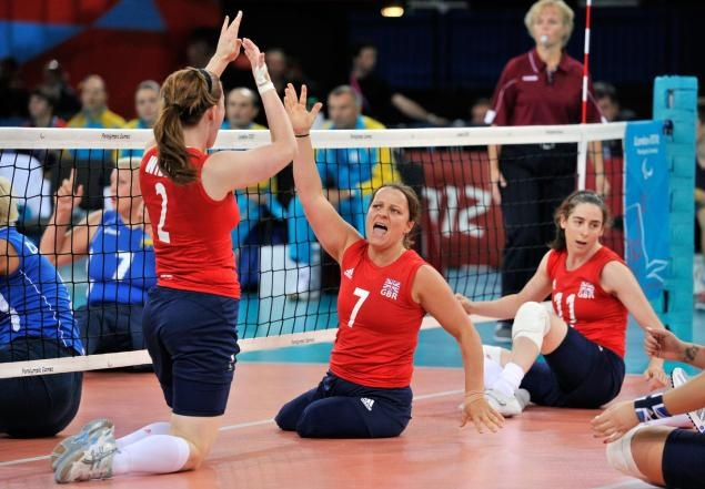 Great Britain's Martine Wright (2nd from the right) celebrates a point with team-mate Victoria Widdup (left) during their women's sitting volleyball match against Ukraine during the London 2012 Paralympic Games     CNN: Live: All the action from London Games  At Home: They can amaze