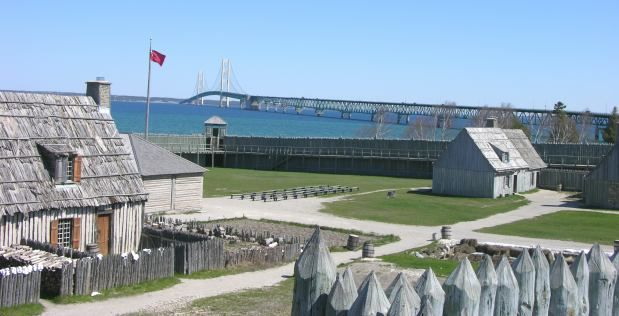 Coloniial Michilimackinac fort in Mackinaw City with Mackinac Bridge in background - old with new in one photo
