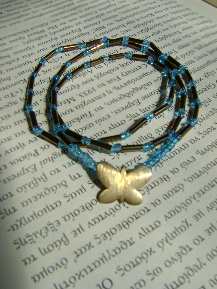 bracelet with beads and a little golden butterfly