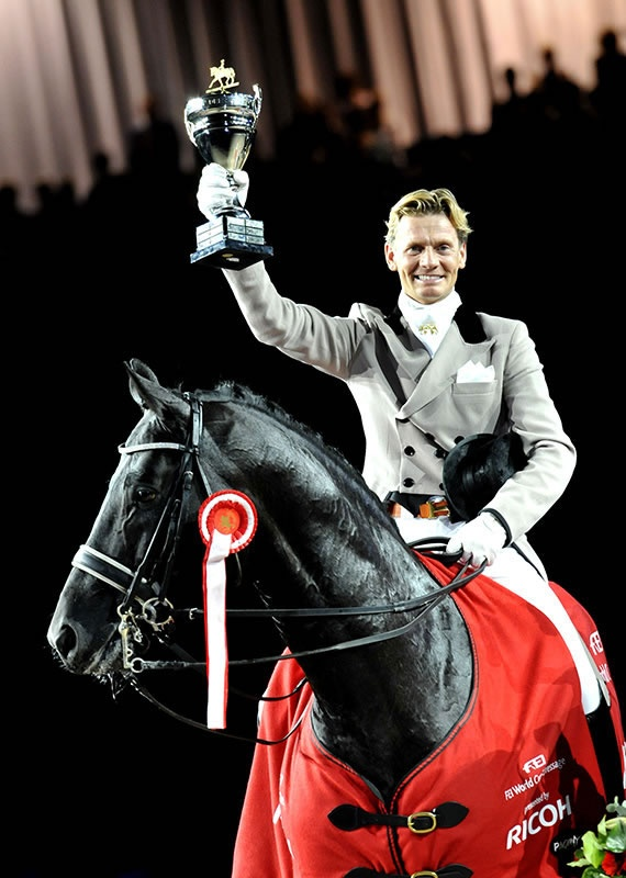 Edward Gal & Moorlands Totilas - when the Olympic announcer says that the only thing the judges penalized was the horse hitting his jaw with his knees in the extended trot...you know you got a DAMN FINE HORSE.