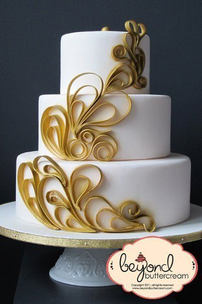 A white wedding cake with gold art deco details-- Love it! {Beyond Buttercream}