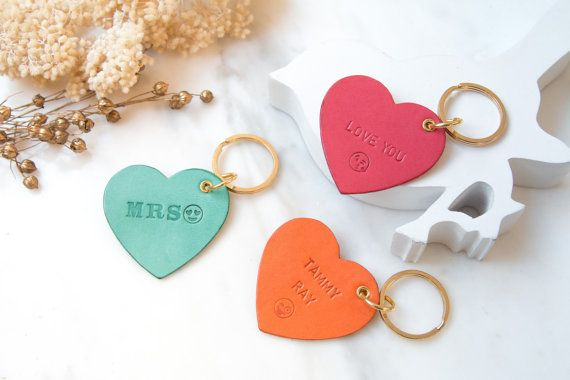 Heartful piece of keychain or bag charm with personalized touch for having name or initial embossing, it made a great gift ever. Best for wedding favors, bridal shower party gift, or corporate gift for VIP or guests.  ★ THIS IS FOR ★ : - Heart shape design with gold ring accessory - Personalized name or initial embossing with funny emoji icons add on  - Monogrammed Leather keychain/ Leather handbag charm/ Leather key ring/ Bridesmaid gift/ Best friend gift/ Birthday gift/ Anniversary gift…