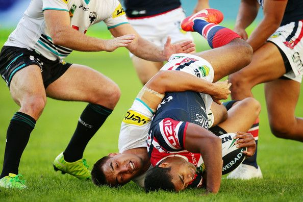 Michael Jennings of the Roosters is tackled during the round eight NRL match between the Sydney Roosters and the Penrith Panthers at Allianz Stadium on May 5, 2013 in Sydney, Australia.