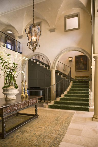Michael Berman Limited - Interior Designer - Los Angeles - Tuscan - Foyer - Entryway - Cream - Neutrals - Wood Desk - Display Table - Chandelier - Hanging Lamp - Arch - Column - Staircase - Tiled Floor - Windows