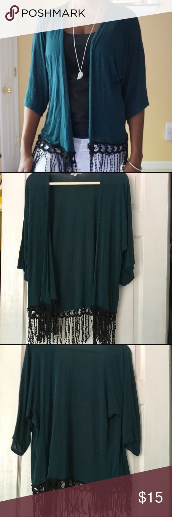 """Fringe Kimono Extremely comfortable Kimono with beautiful fringe detail at the hem. Super light weight, you can wear it all year around. Cold office, restaurant, or movies theater because of the AC? Or even a breezy day, throw this stylish kimono in your bag and you'll be good to go!   ▪️Wide Sleeves ▪️96.5 Rayon 3.5% Spandex       Model Measurements:  5'7"""" 