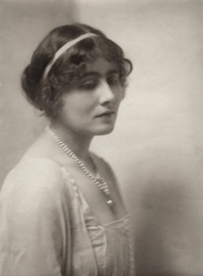 Elizabeth Bowes-Lyon (1900 - 2002). Wife of George VI. Queen from 1936 - 1952. Mother of Elizabeth II and Princess Margaret. Adolf Hitler called the most dangerous woman in Europe because of her ability to boost British morale. She was always extremely popular, even when the rest of the royal family were disliked by the public. She died aged 101 in 2002.