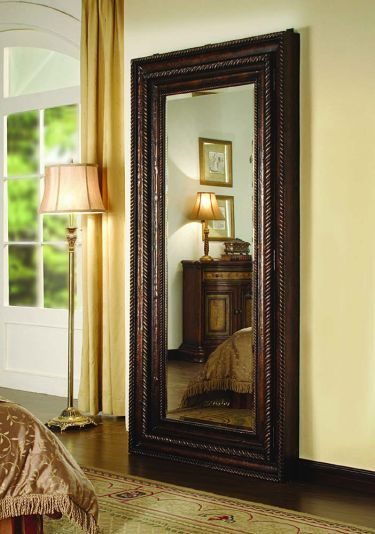 This mirror is a door to jewelry storage!  Floor Mirror with Hidden Jewelry Storage - Hooker Furniture