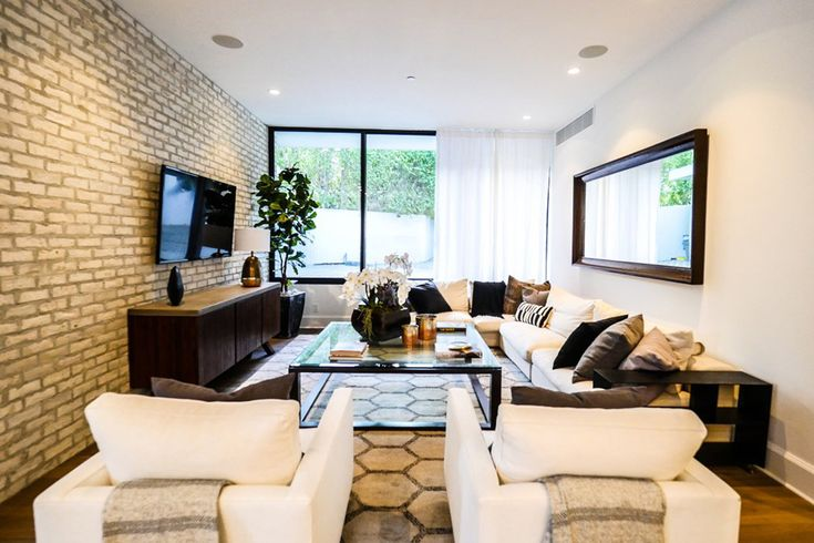 See Inside the Home Kendall Jenner Just Bought from Emily Blunt for $6.5 Million - The Living Room from InStyle.com