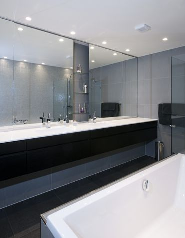 Big mirrors gives the feeling of spaciousness, Black tiled bathroom. Interior architecture | Ramsoskar
