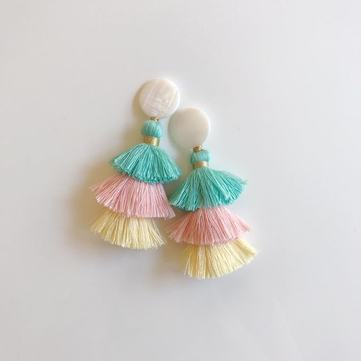 mother of pearl + mint, pink, yellow tassels  colors of my nursery