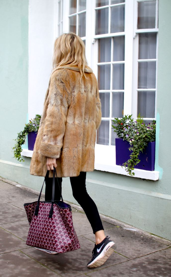 Lucy Williams looking cosy in fur and sneakers