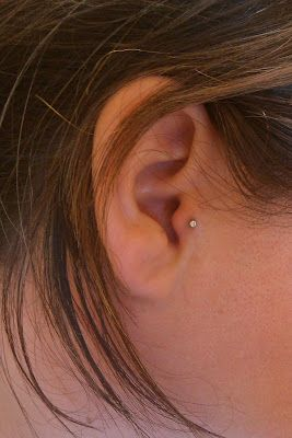 ok, so not inkage, but I like the look of the tragus pierced ... this image was the pinners personal upload