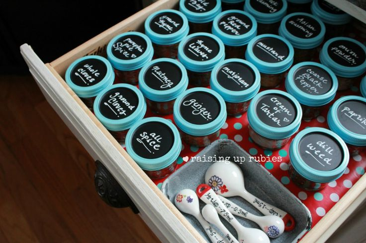 Chalkboard spice jars ... ♥ I may need to convert one of my junk drawers. Pint sz canning jars, black c.board paint. (she used wrapping paper from H.Lobby to line her drawers) measuring spoons.
