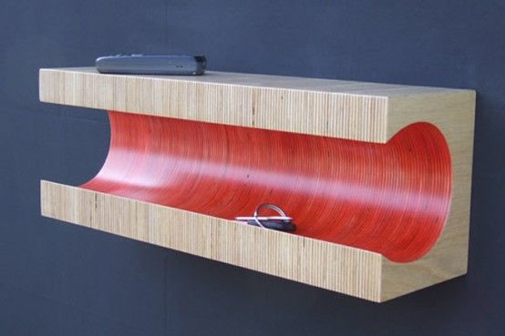 To make this unusual shelf designer Martin Gallagher took many layers of plywood. He made a block of them and painted just the inner part.