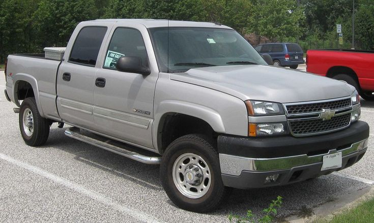My 5th (and current) vehice: 2004 Chevy Silverado 2500HD, 6.6L Duramax Diesel with Allison 6-speed automatic transmission.  Mine has tow mirrors, no siderails.  Added V-plow in 2011.