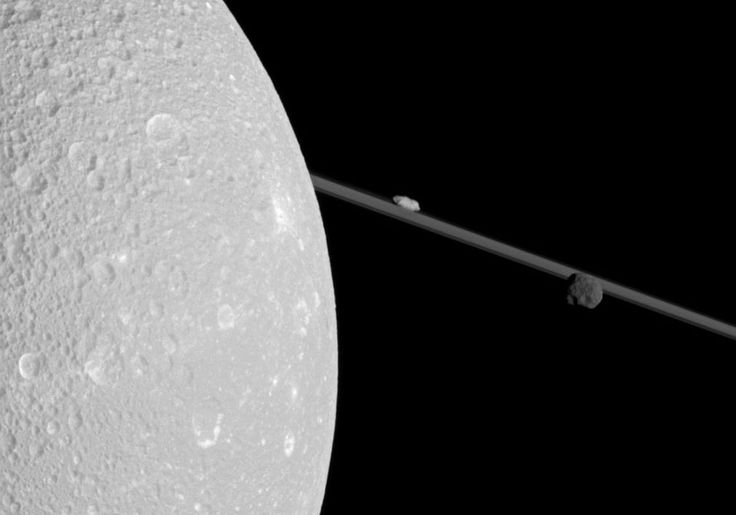 What's that past Dione? When making its closest pass yet of Saturn's moon Dione late last year, the robotic Cassini spacecraft snapped this far-ranging picture featuring Dione, Saturn's rings, and the two small moons Epimetheus and Prometheus.