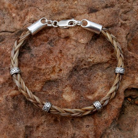 Keepsake horse hair made into jewelry.  Much better than having it stuck in a box somewhere.  High Hopes Designs - Custom Horsehair Jewelry: