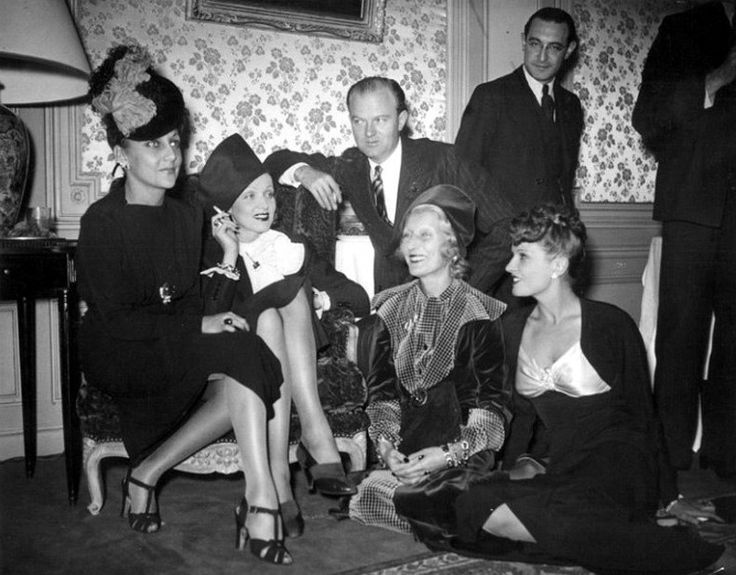 Mrs. Jack L. Warner, Marlene Dietrich, Anderson Lawler, Vera Matzouki and Lili Damita at a cocktail party given by Damita at the hotel Plaza Athénée in Paris. November 1938