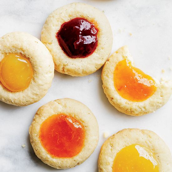 Cardamom Thumbprints | Adding cardamom to these crispy cookies gives them a subtle spiced flavor. You can fill the thumb print with other jams or with chocolate.