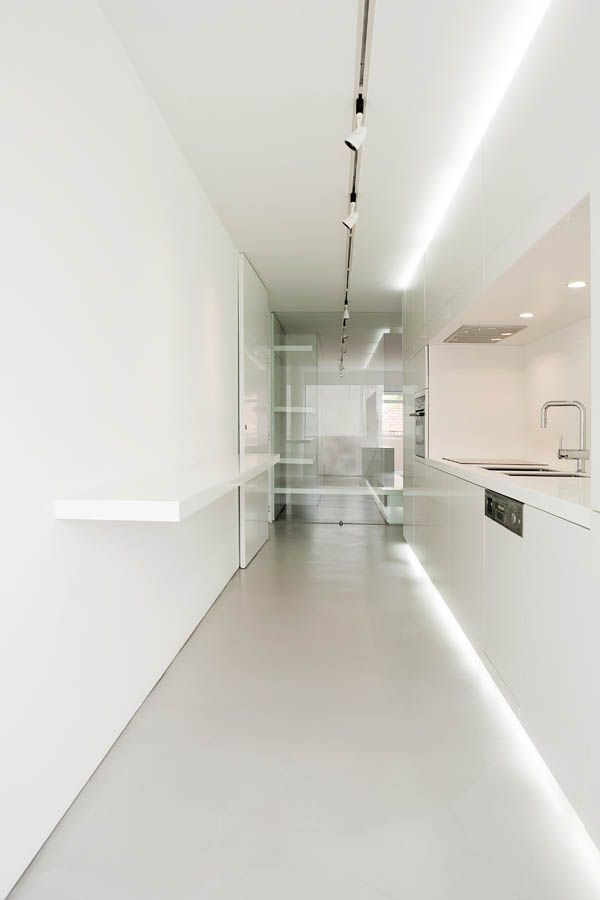 White kitchen, Aveiro apartment in Portugal by Artspazios Arquitectos _