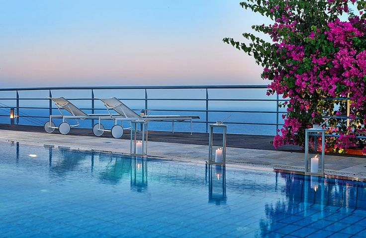 Relax by the pool and enjoy the view of Aegean in Ammoudi