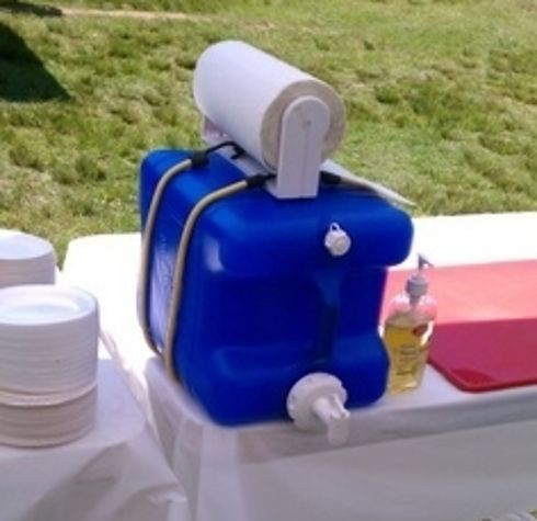Use an empty laundry detergent dispenser as a hand-washing station. | 41 Camping Hacks That Are Borderline Genius