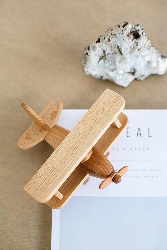 Item is hand made from beech wood. Wheels and propeller spinning. 100% eco-friendly material. The toy is absolutely safe, it can be gnawed. Grandfather Grigory thoroughly polishes every detail and covers it with organic oil. Jaromir likes to take the plane in his hand and depict the