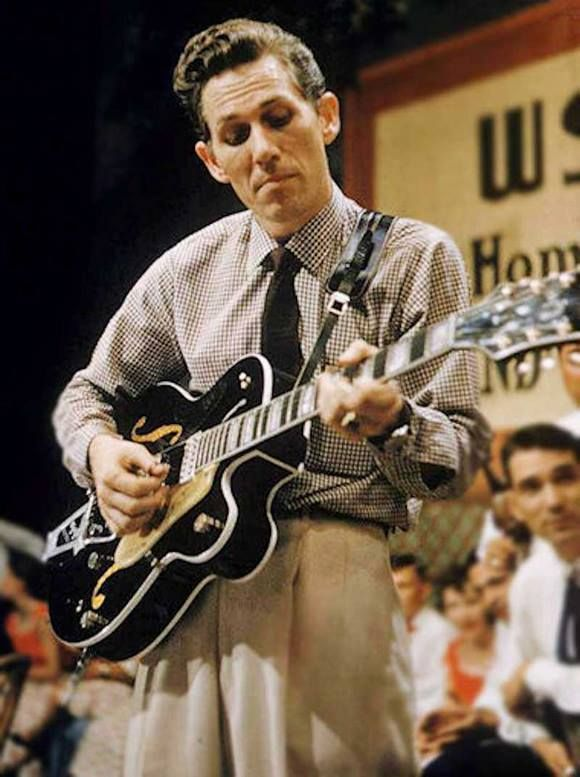 Chet Atkins playing one of the classic Gretsch archtops he helped design                                                                                                                                                                                 More