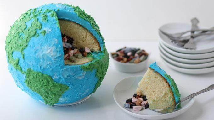 This Earth-shaped cake hides a core of chocolate rock candy. Perfect for celebrating Earth Day!
