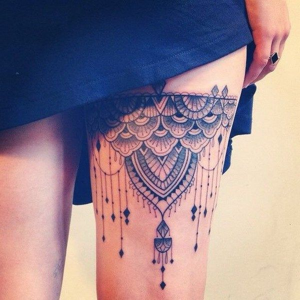 Stunning Thigh Tattoo with Lace Design.