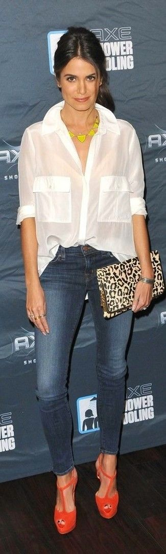 Nikki Reed wearing White Button Down Blouse, Navy Skinny Jeans, Orange Suede Heeled Sandals, Beige Leopard Leather Clutch