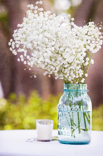 Mason jar with baby's breath flowers centerpiece weddingcenterpiece masonjar weddingdecor weddingideas