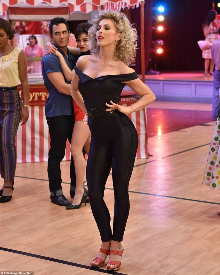 It's electrifying! Julianne Hough's sexy Sandy leads Grease Live to five star reviews and high ratings after dodging torrential rain and overcoming sound issues on Sunday night