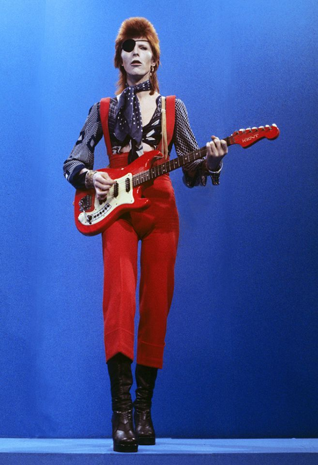 "RIP David Bowie (bio): David Bowie performs ""Rebel Rebel"" on the TV show TopPop on Feb. 7, 1974 in Hilversum, Netherlands. (Photo: Redferns)"