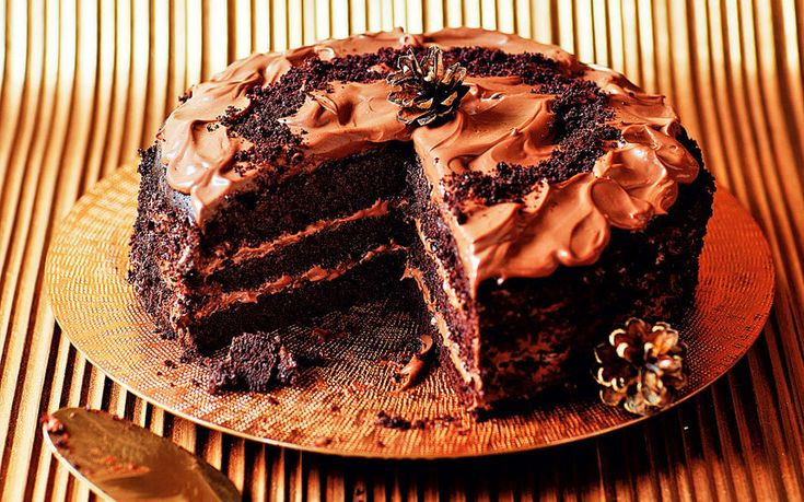 The ultimate chocoholic's dessert: a rich three-layer cake with   chocolate-custard icing