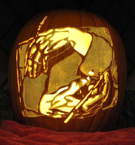 M c escher drawing hands carved on a pumpkin by
