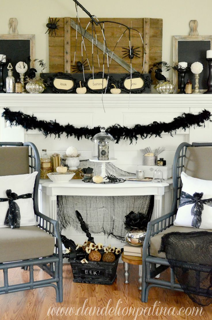 Black and white Halloween inspired mantel with rustic touches to create that spooky and creepy Halloween decor. Creep & Crawl Halloween Mantel - Dandelion Patina