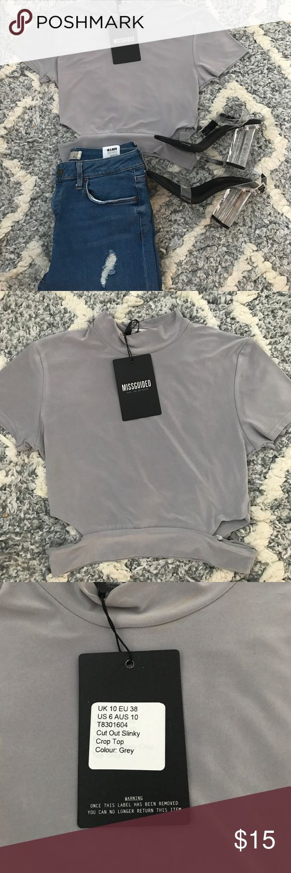 Sexy Missguided top Sexy silver grey missguided top. Depending on how high waisted hour jeans are this top could show your stomach or not. Two cut outs on each side. No damage never been worn Missguided Tops Crop Tops