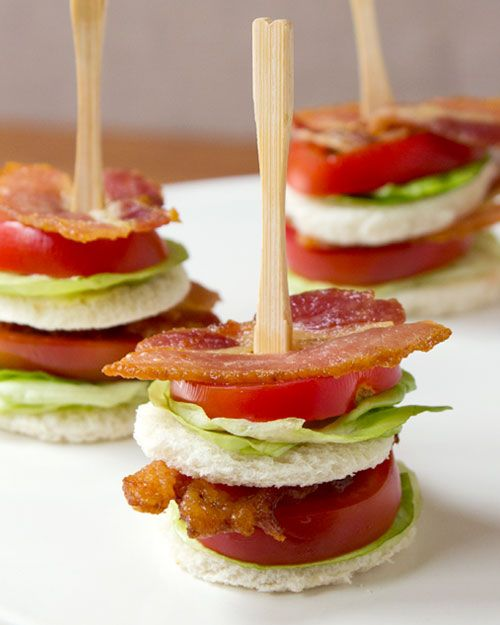 A mini, two-bite version of a classic BLT. This one is double-stacked and open faced, held together by a cocktail fork.