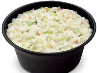 Chick-fil-A's cole slaw: 4 teaspoons vinegar; one-fourth cup sugar;  three-fourths teaspoon dry mustard;   one-fourth teaspoon salt;   1 cup mayonnaise;  2 bags (10 oz. bags) fine shredded cabbage, chopped to one-eighth inch; one-fourth cup finely chopped carrots