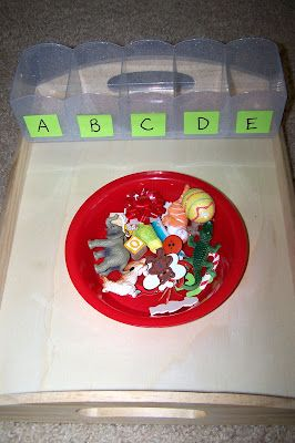 Beginning sound sort, for children beginning to understand leading letter sounds. I would also put a lower case letter on each container to help with letter recognition. EYFS