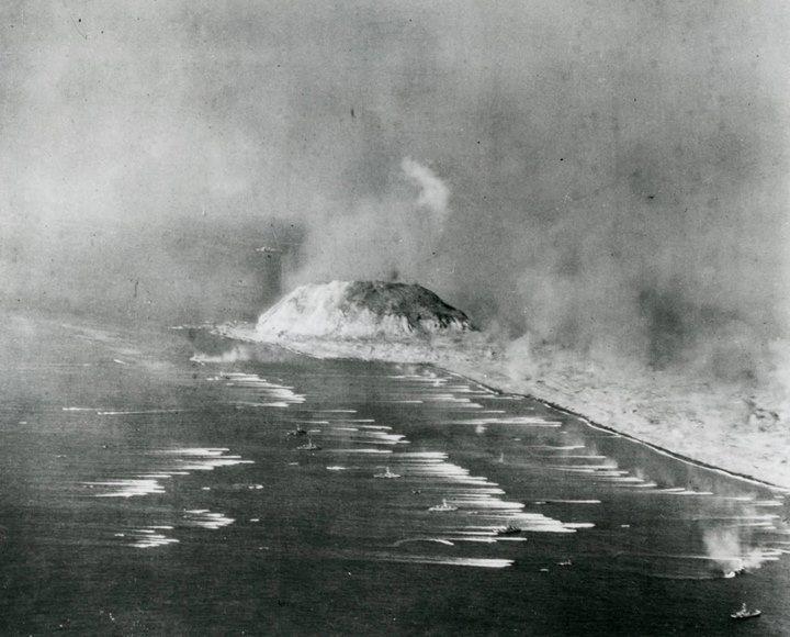 US 6th Fleet off Iwo Jima Japan 19 February 1945. Note Mount Suribachi in background.