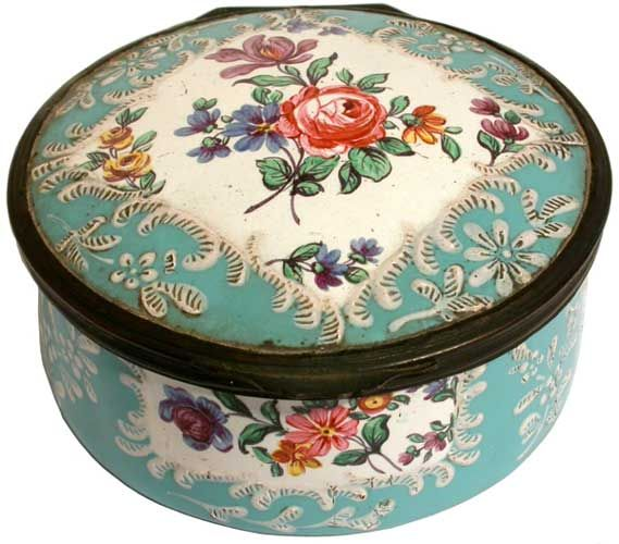 A 'Honeysuckle Group' Staffordshire circular enamel box painted with flower sprays within shaped reserves on a pale blue ground, gilt metal mounts, minor hair crack to underside of base, circa 1765, 3.5in diameter.