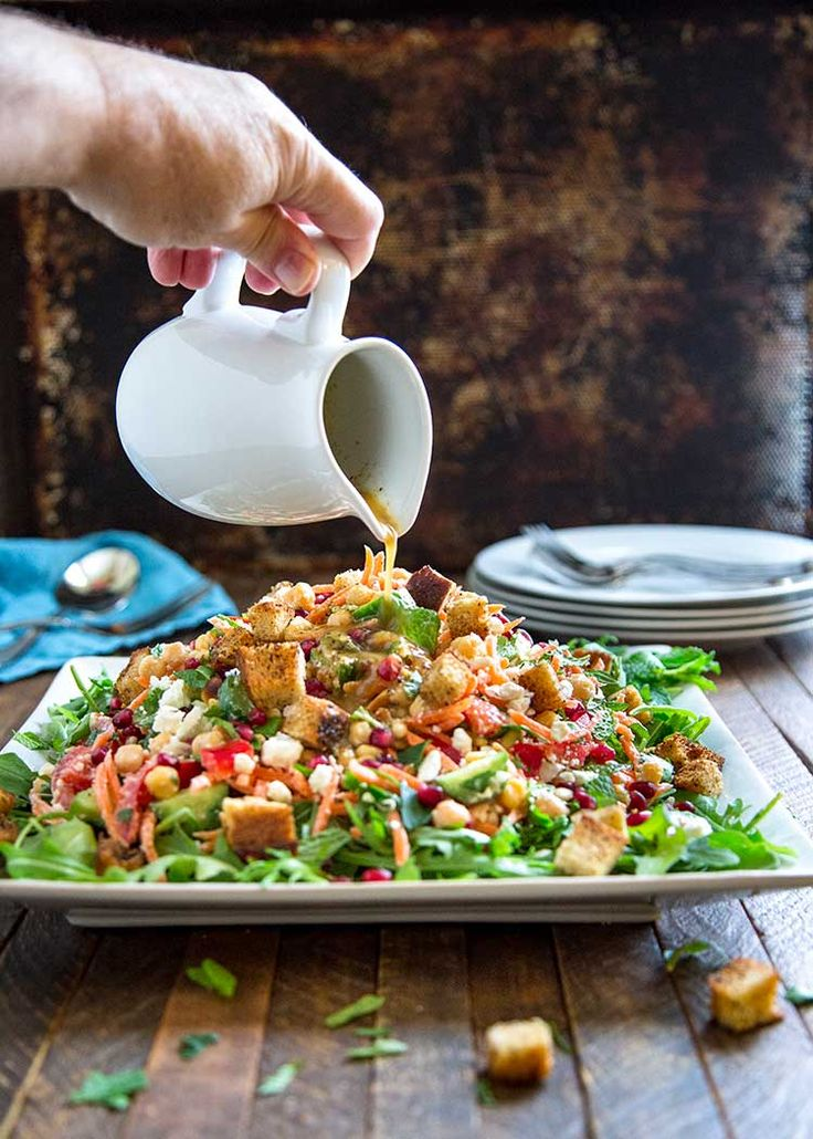 This Moroccan Chickpea Carrot Salad with Za'atar Croutons is chock full of shredded carrots, chickpeas and other veggies and pomegranate, feta and toasted pine nuts, but the kicker is the lemon and cumin dressing that brings this all together. Topped with crunchy homemade za'atar spiced croutons and dinner is serve