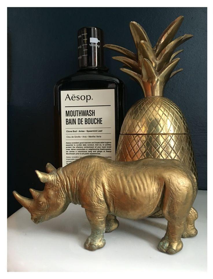 Brass vintage pineapple, apothecary, gold spray paint rhino, Hague blue farrow House Tour: Our Blue, Brass bathroom