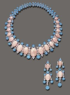 A SUITE OF CORAL, TURQUOISE AND DIAMOND JEWELRY Comprising a necklace, the tapering flexible band enhanced at the front by a series of graduated cabochon coral, spaced by circular-cut diamond geometric links, enhanced by cabochon turquoise trim, each surmounted by a diamond collet, to the backchain of similar design; and a pair of ear pendants en suite, mounted in 18k white gold, necklace 14¼ ins. The total weight of the diamonds is approximately 11.00 carats