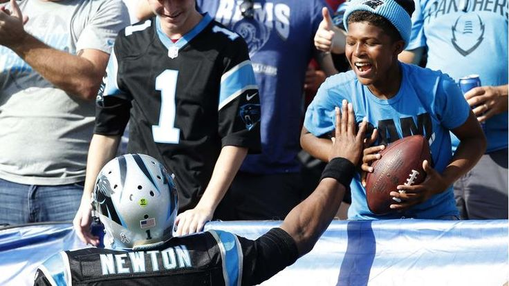 Panthers vs. Rams:  13-10, Panthers  -    Cam Newton  -  Panthers quarterback Cam Newton delights a young fan by tossing him the ball he threw for a touchdown to tight end Greg Olsen in the first quarter.